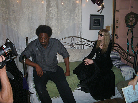Host Kamau Bell talking with Lady Passion.