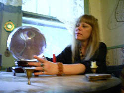 Clairvoyant psychic reader, divination specialist Lady Passion using a crystal ball to give a psychic clairvoyant reading and divination